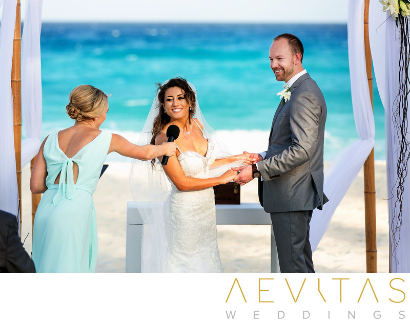 Candid couple photo at Cancun beach wedding ceremony