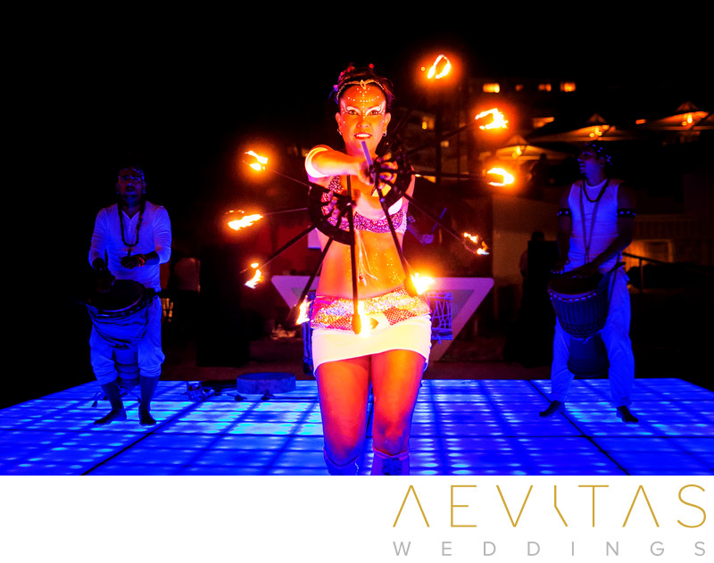 Fire dancing performance at Cancun beach wedding