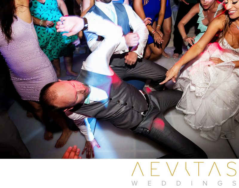 Groom getting down at Cancun beach wedding reception