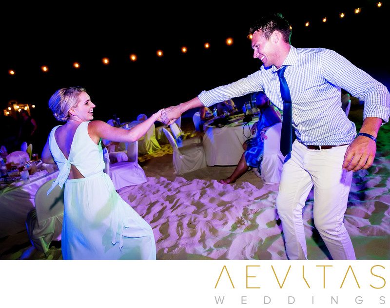 Bridesmaid dancing at beach wedding reception in Cancun