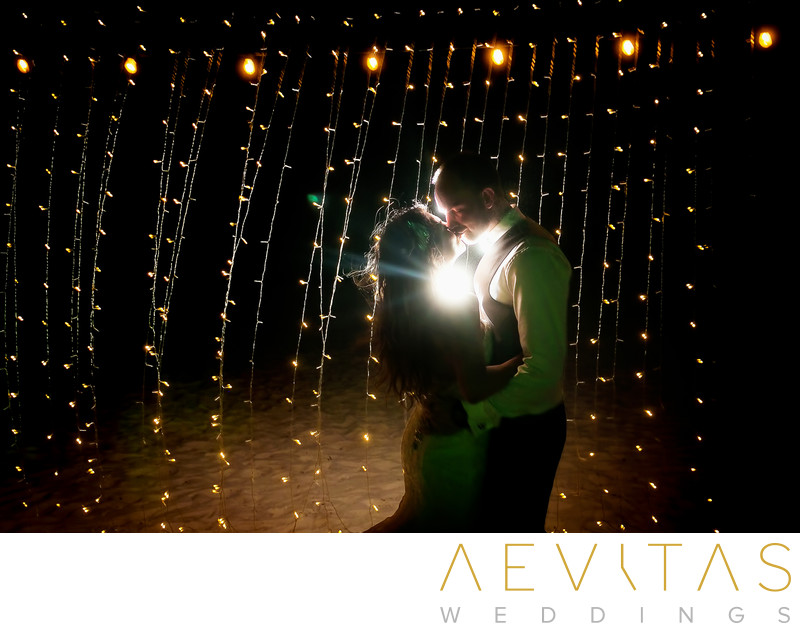 Nighttime couple photo by Cancun wedding photographer