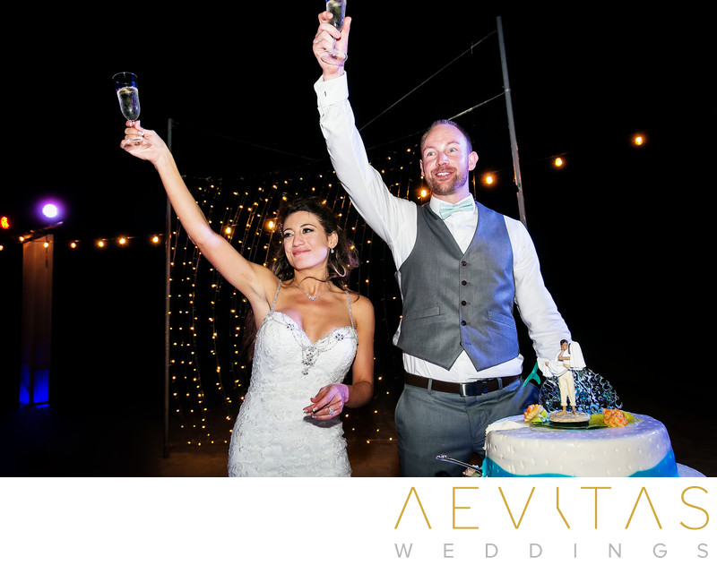 Couple make champagne toast at Cancun wedding reception