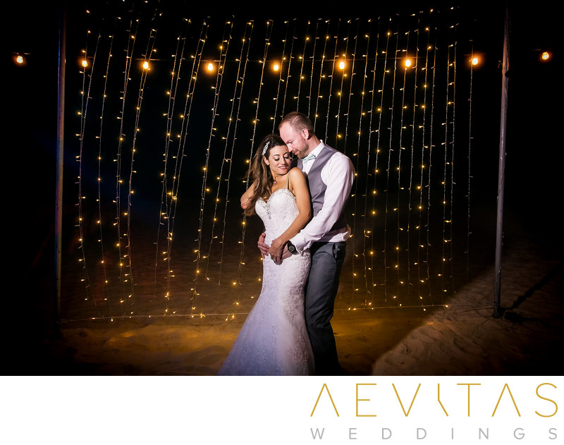 Romantic couple portrait with string lights in Cancun