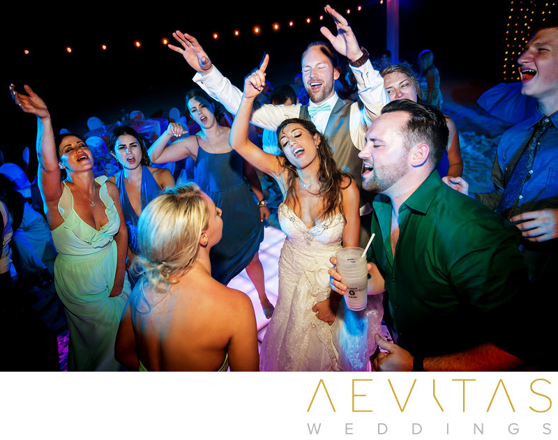 Bride and groom dancing with friends at Cancun wedding
