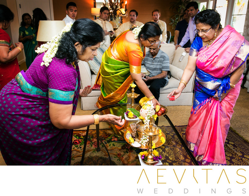 Indian women prepare wedding offerings in hotel suite