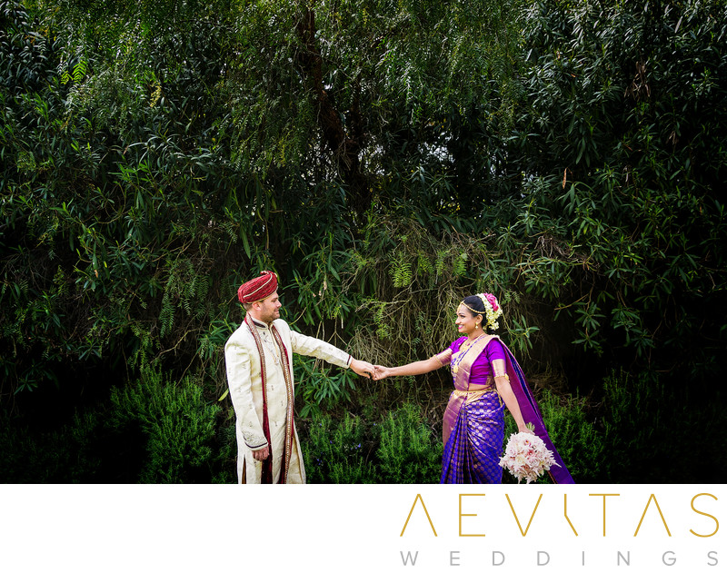 Indian wedding couple portrait with natural greenery
