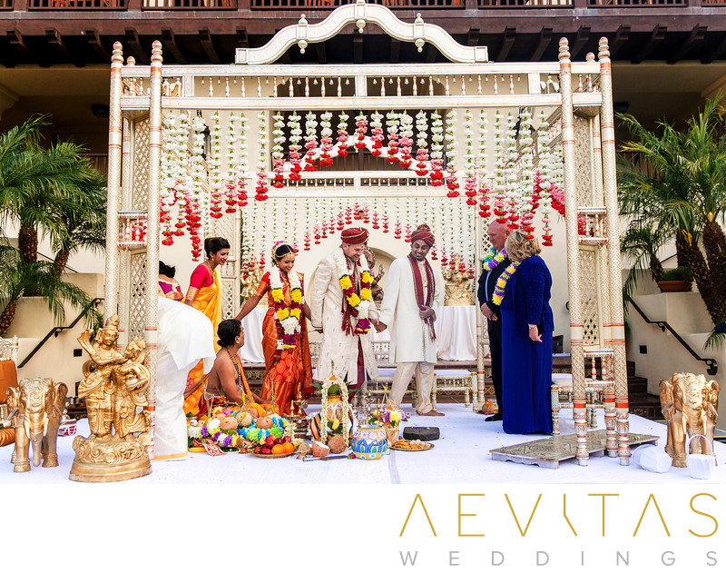 Couple walk around mandap stage during Indian wedding