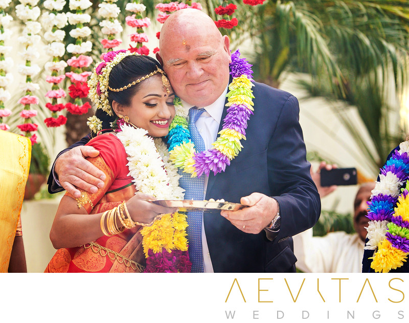 Candid bride and father-in-law photo at Hindu wedding