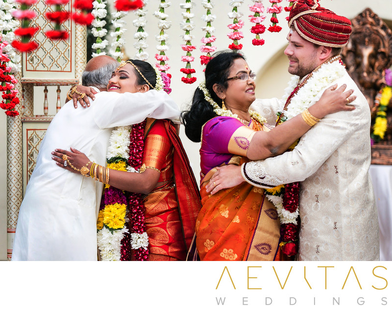 Family embrace at Hindu wedding in San Diego