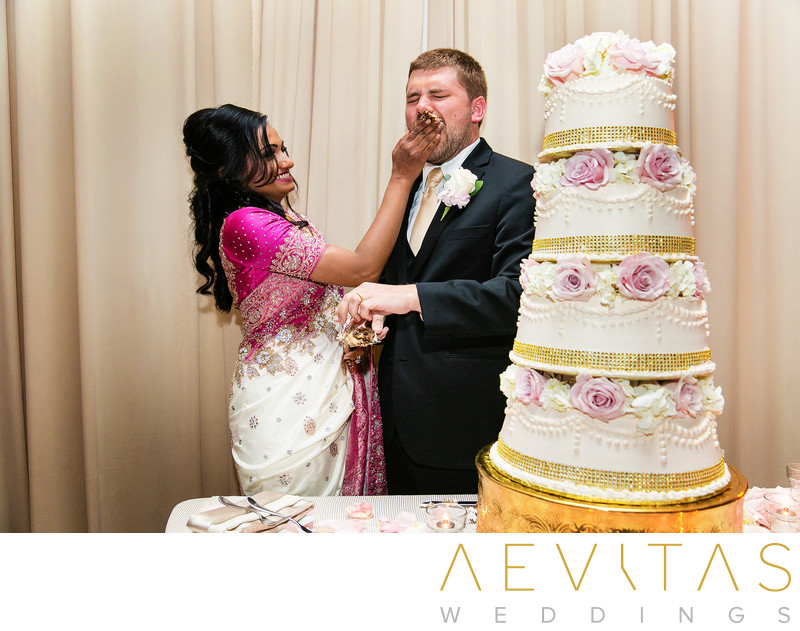 Couple smash cake at Estancia La Jolla reception