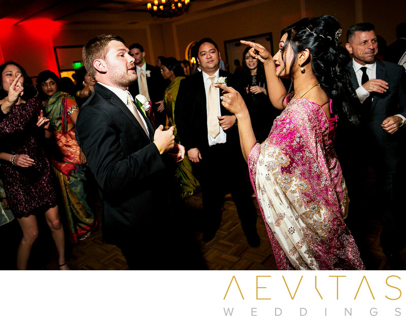 Bride and groom dancing at Estancia La Jolla reception