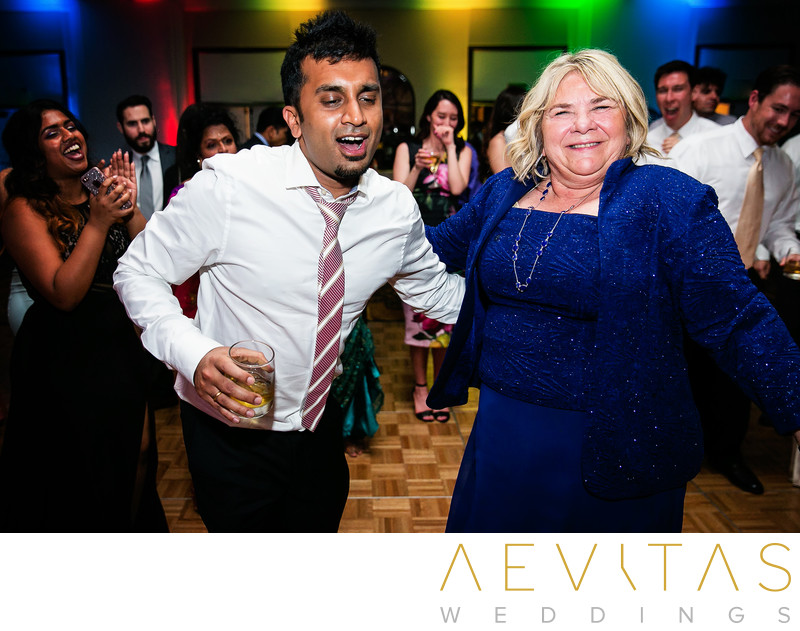 Wedding guests dancing by San Diego photographer