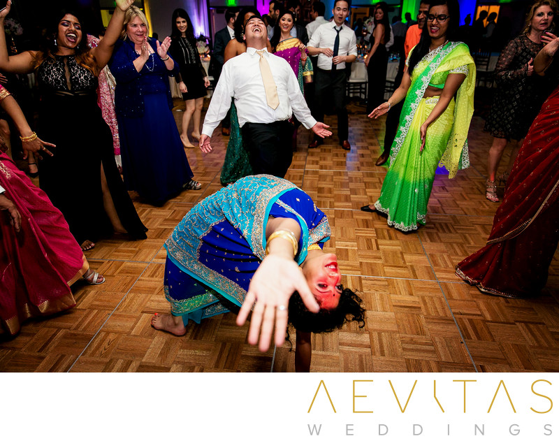 Woman does backbend in sari at Indian wedding