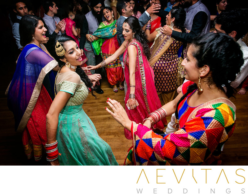 Creative photo of bride dancing at Indian wedding party