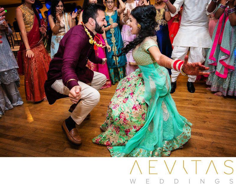 Bride and groom getting down dancing at Sangeet party