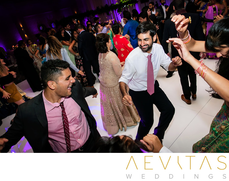 Playful dance floor photo at Indian wedding party