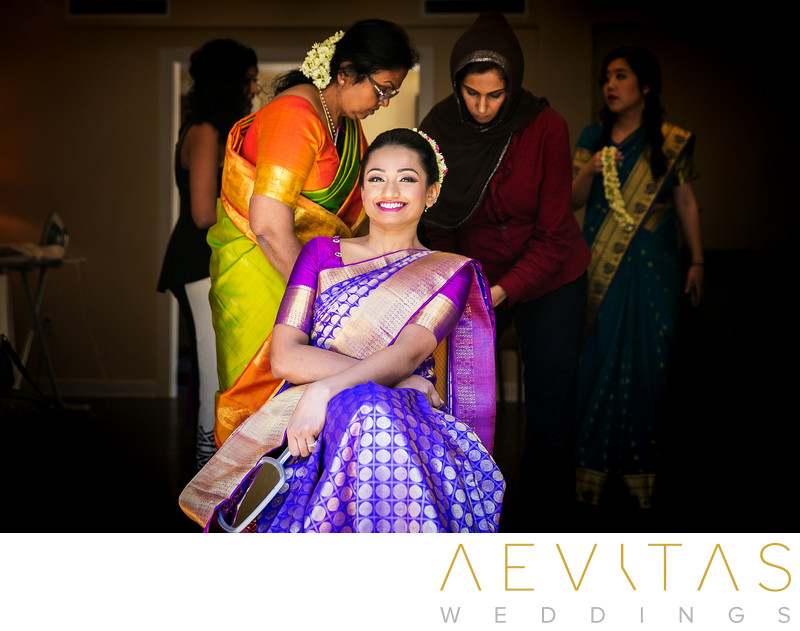 Bride getting ready by Indian wedding photographer