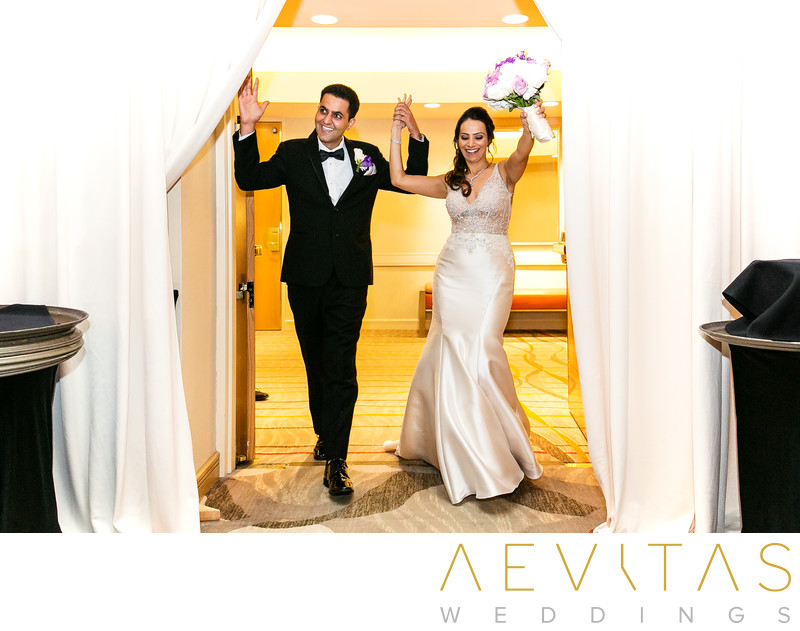 Couple grand entrance Hotel Irvine ballroom reception