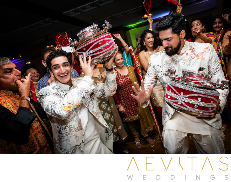 Men dancing with red drums at Indian wedding party