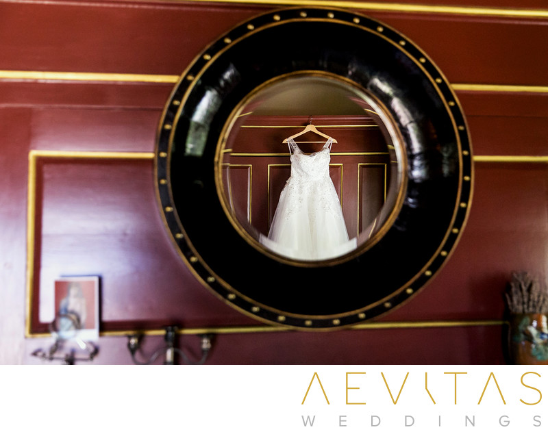 Reflective photo of bride's wedding dress in mirror