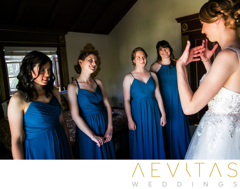 Emotional bride with bridesmaids by LA photographer