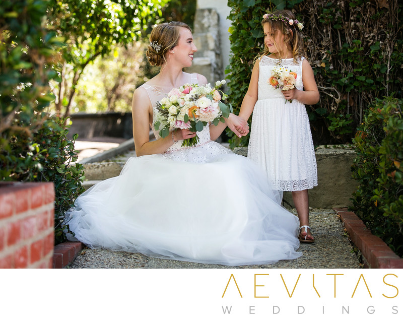 Bride with flower girl in Palos Verdes Estates garden