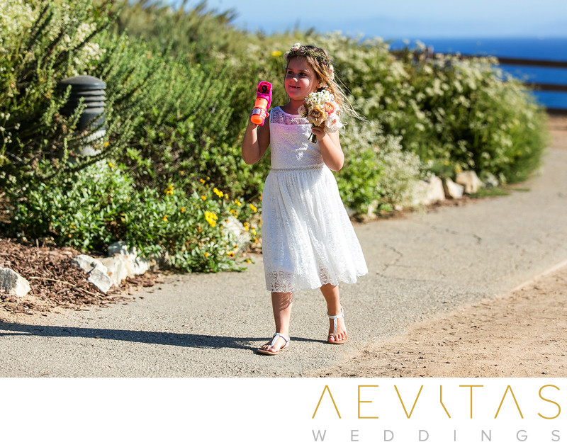 Flower girl arriving at Point Vicente wedding ceremony