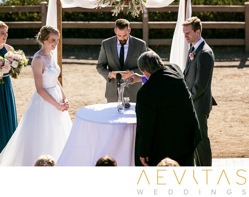 Father pouring sand at Point Vicente wedding ceremony