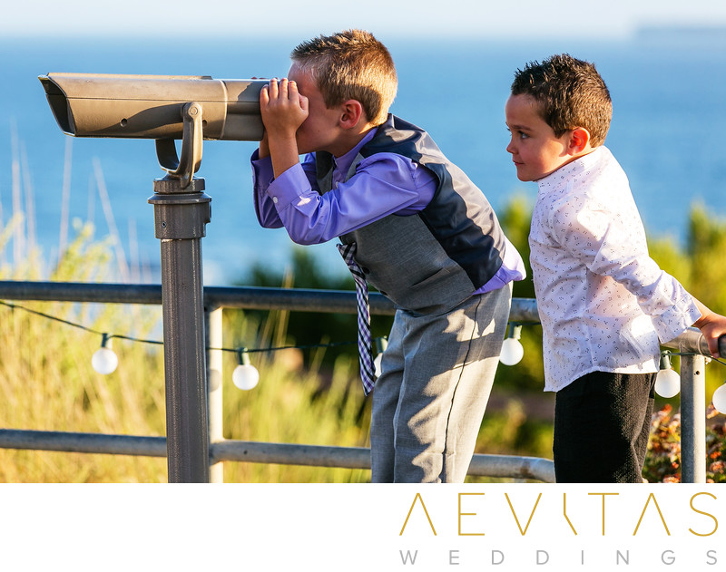 Boys looking through binoculars Point Vicente wedding