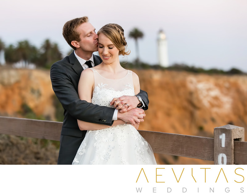 Tender couple portrait with Point Vicente Lighthouse