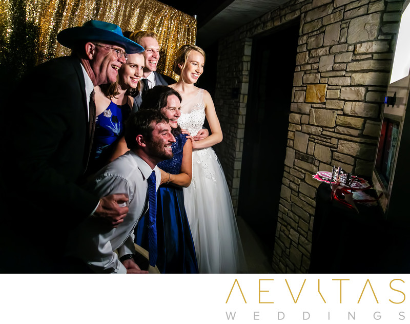 Family in photo booth Point Vicente wedding reception