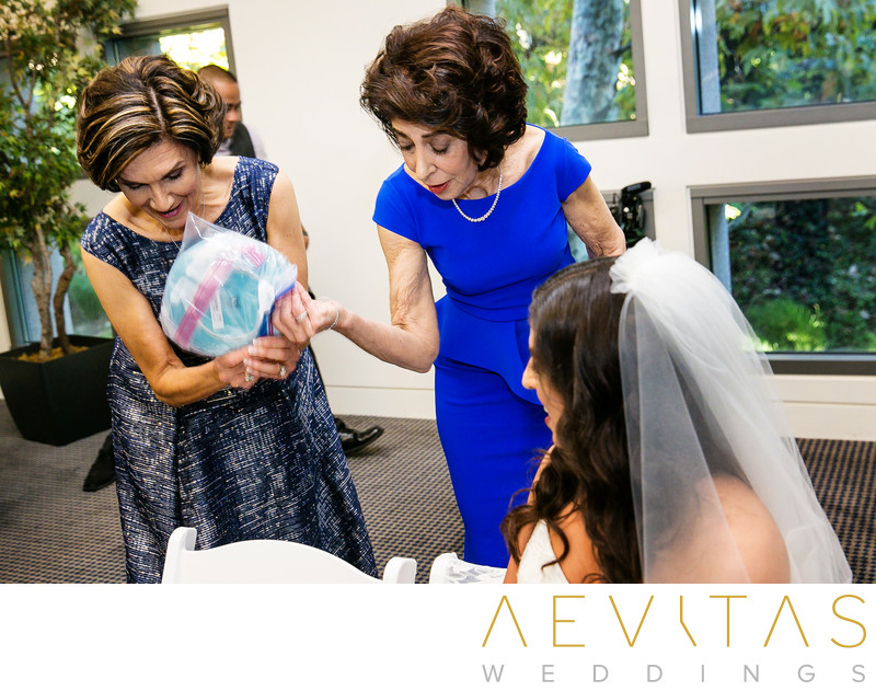 Candid moment between bride and moms at Bedeken in LA