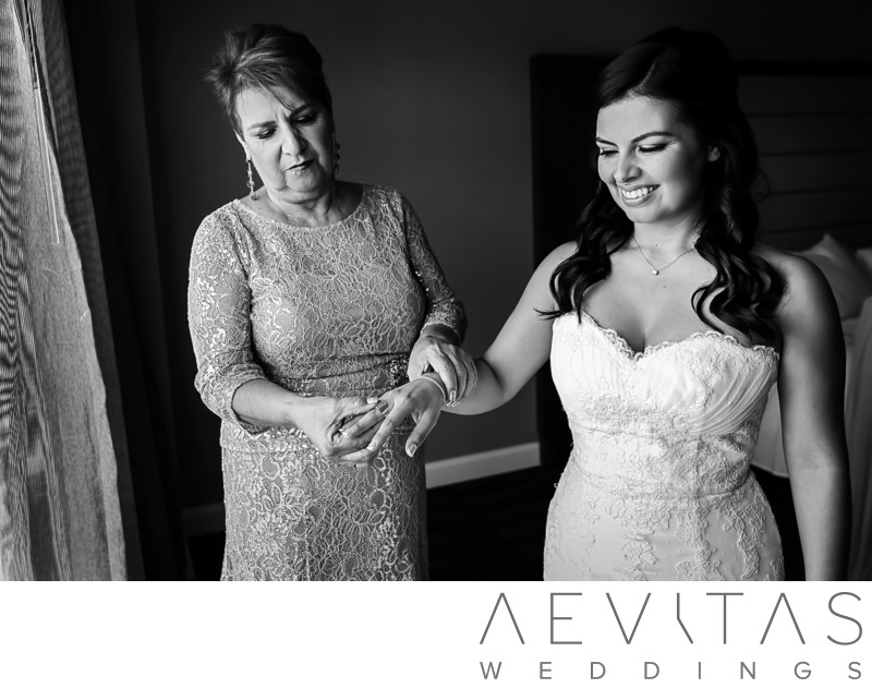 Candid mother and bride moment at Glendale wedding