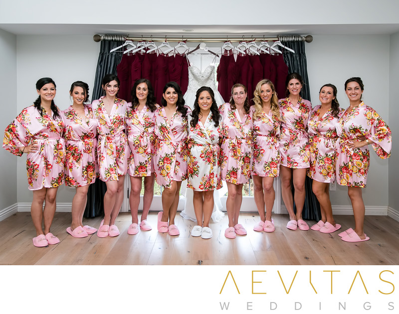 Bridesmaids in pink floral robes at Los Angeles wedding