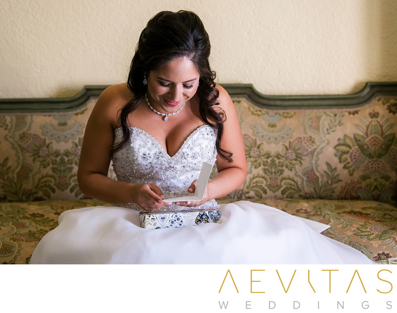 Bride reads note card from groom at The Ebell of LA
