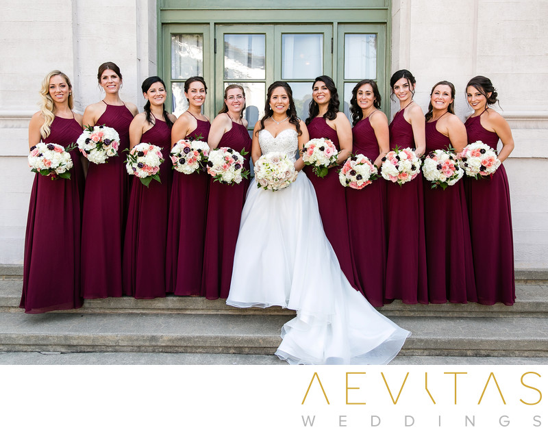 Bride with bridesmaids portrait outside The Ebell of LA