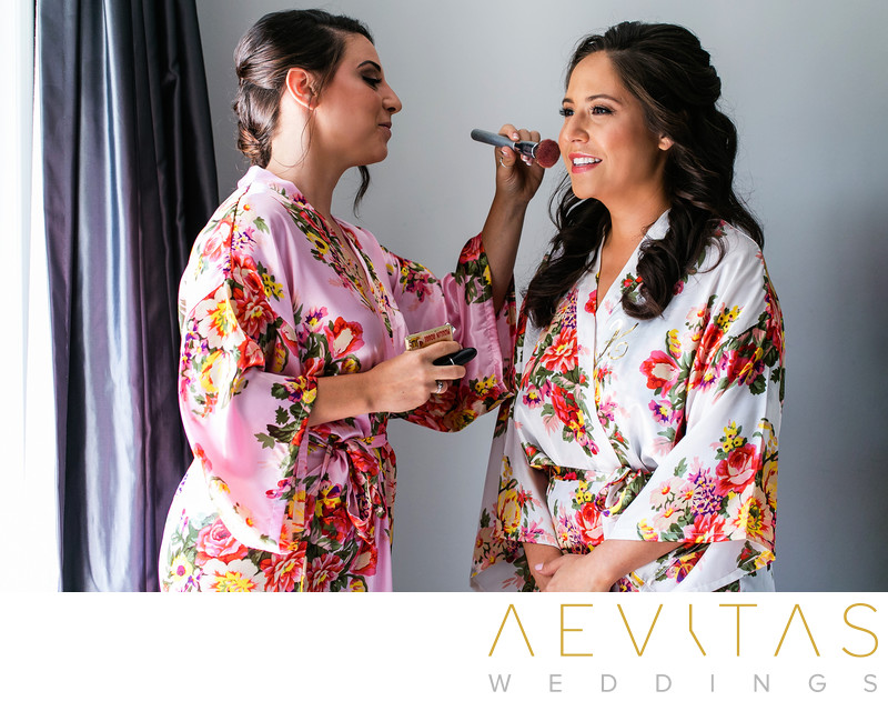 Bride and maid-of-honor in floral robes in Los Angeles