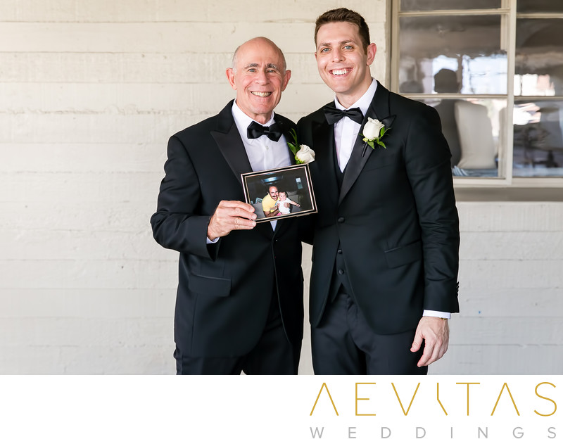 Groom and dad with photo frame at LA wedding