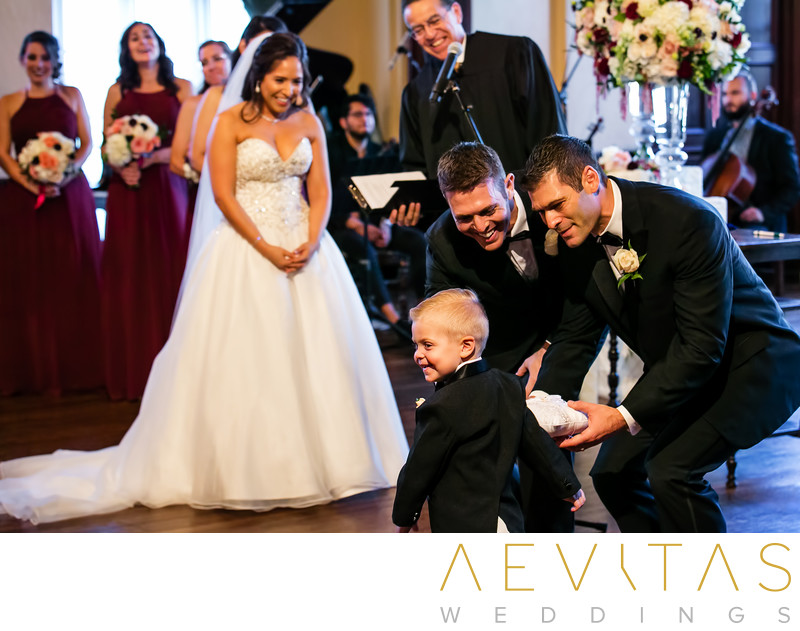 Cute ring bearer at Los Angeles wedding ceremony
