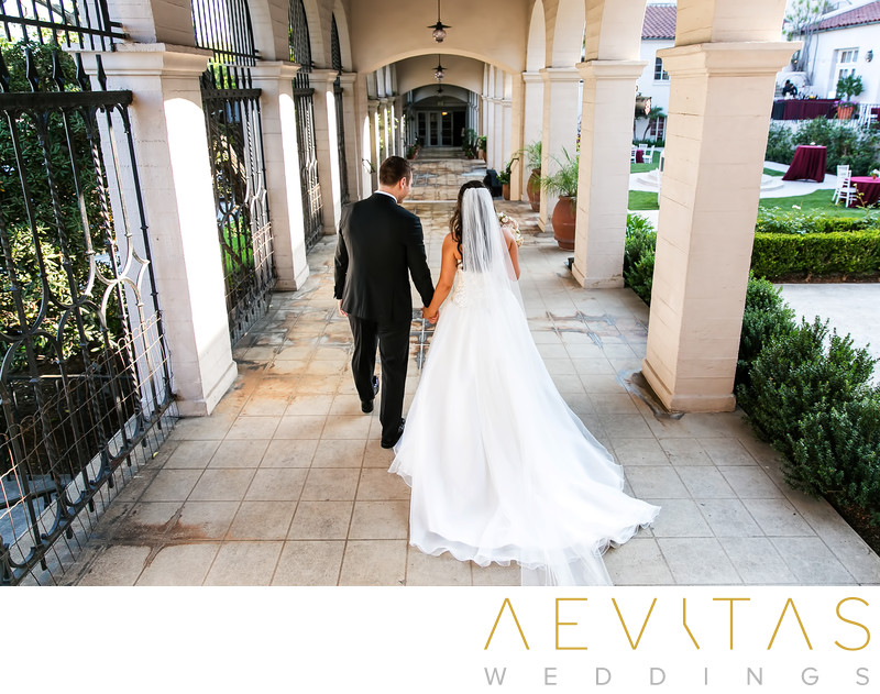 Couple walking through colonnade Ebell Los Angeles