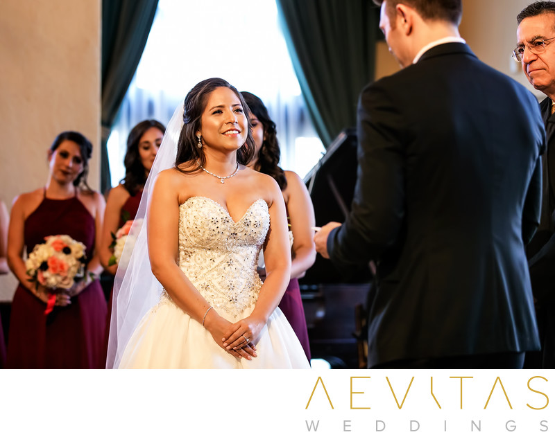 Bride listens to groom's vows at Ebell LA ceremony