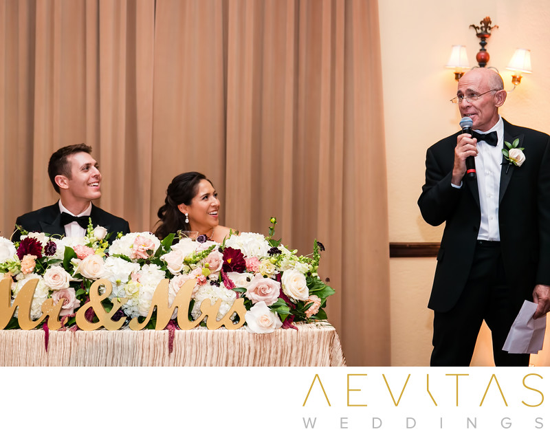 Groom's dad speech with couple at sweetheart table