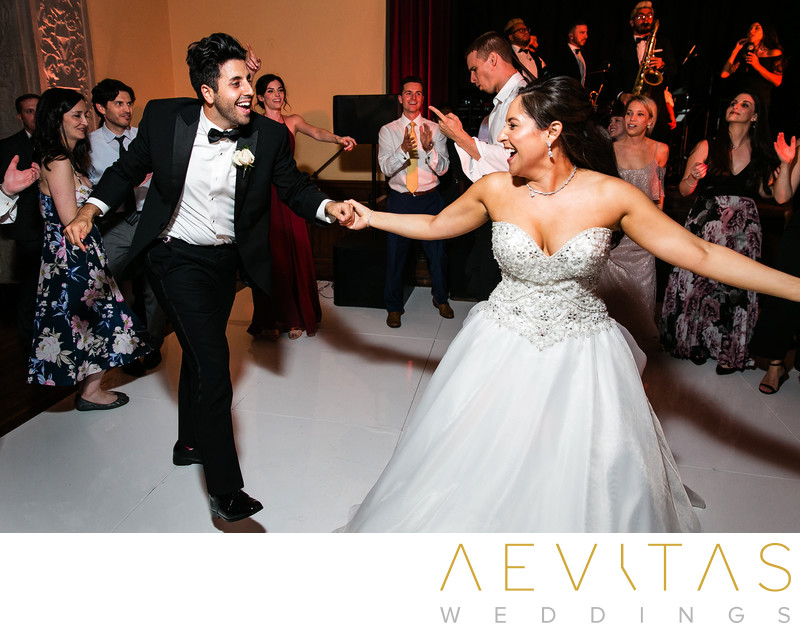 Bride and groomsman dancing at The Ebell of Los Angeles