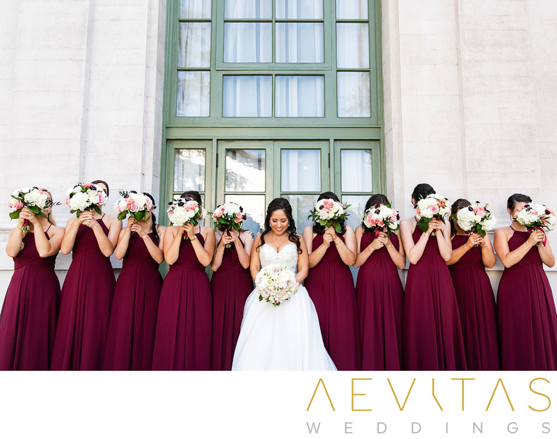 Bridesmaids hiding behind bouquets at The Ebell LA