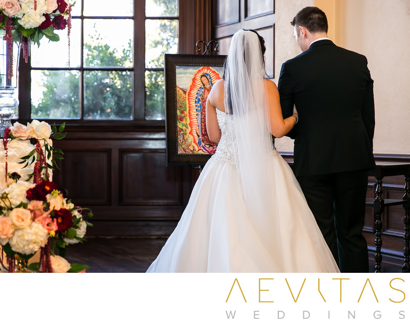 Couple with picture of Mother Mary Los Angeles wedding
