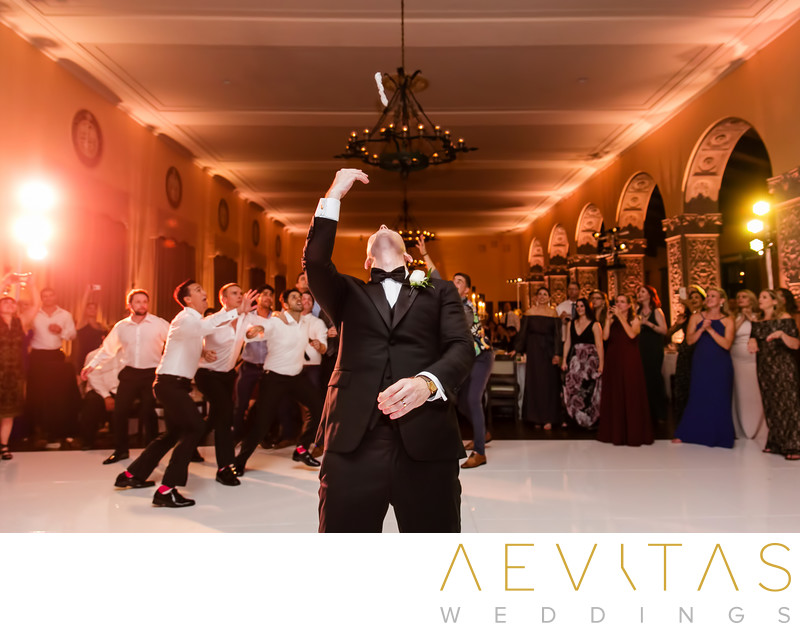 Groom garter toss at The Ebell of Los Angeles wedding