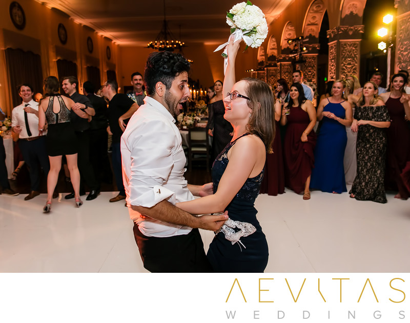 Photo of couple dancing after garter and bouquet toss