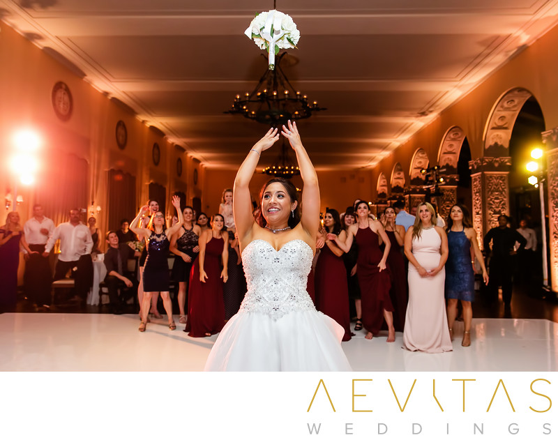 Action shot of bride's bouquet toss at The Ebell of LA