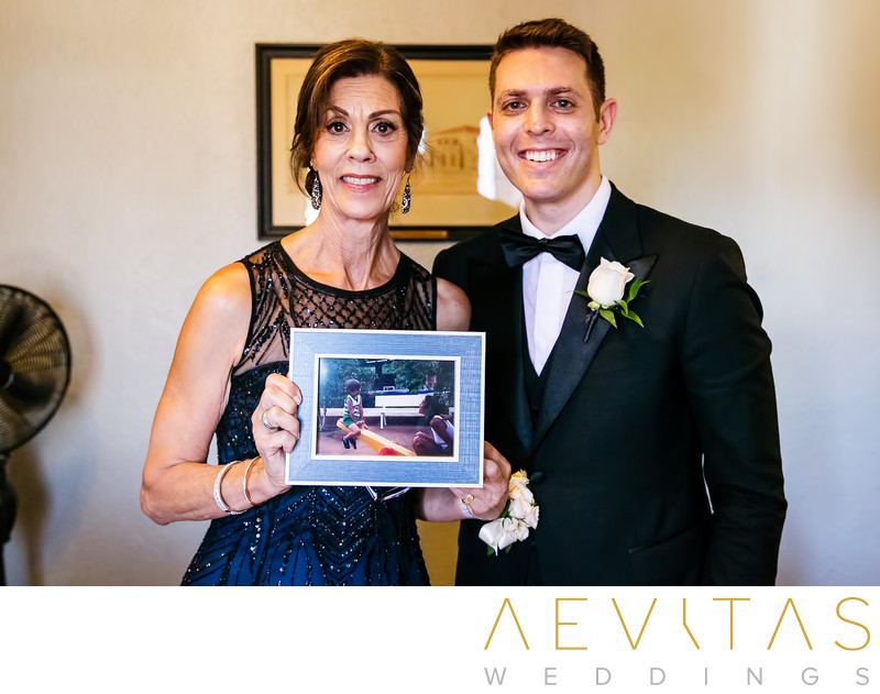Groom and mom with photo at Los Angeles wedding