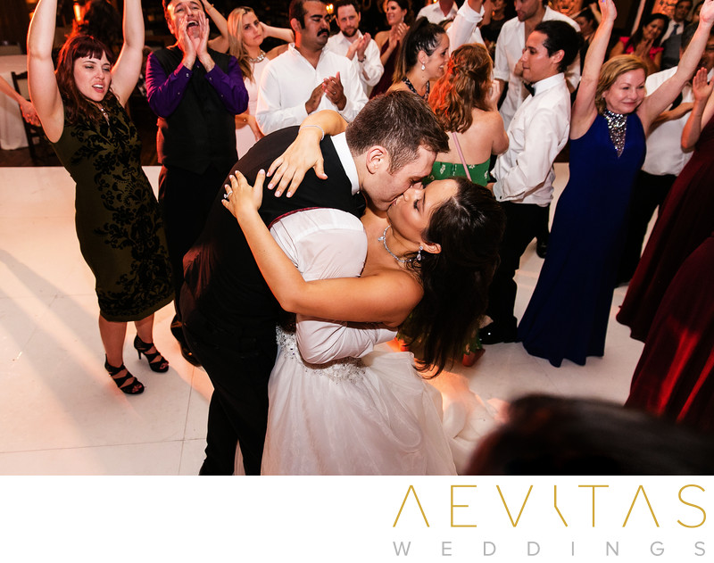 Couple kiss with guests on dance floor at The Ebell LA
